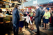 Koningin Maxima opent Markthal Rotterdam, de eerste overdekte versmarkthal in Nederland geïnspireerd op versmarkten elders in Europa.<br /> <br /> Queen Maxima opens in Rotterdam The Market Hall, the first covered market hall  in the Netherland inspired on other markets elsewhere in Europe.<br /> <br /> op de foto / On the photo:  Koningin Maxima krijgt een rondleiding over de markt / Queen Maxima gets a tour of the market