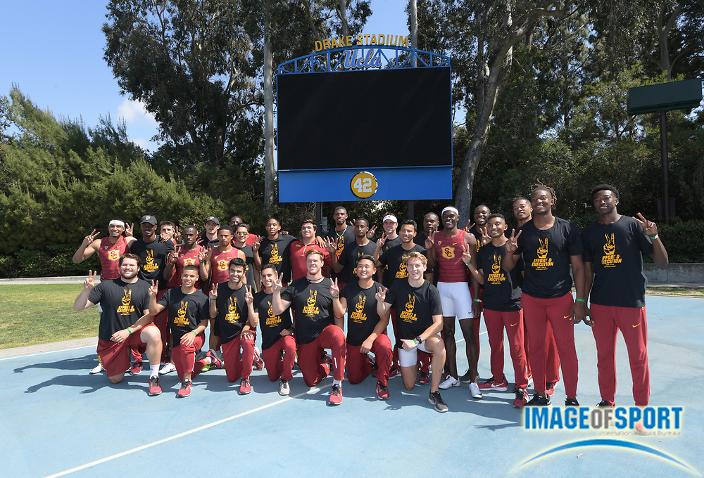Members of the Southern California Trojans men's team pose for a team photo after defeating the UCLA Bruins, 103-53, during a collegiate dual meet at Drake Stadium in Los Angeles, Sunday, April 29, 2018.