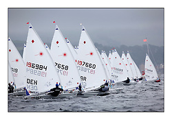 Maiken Schutt, DEN 196984, Alison Young, GBR 197658 and Charlotte Dobson, GBR 197660 on the startline of the women's fleet...Opening races in breezy conditions for the Laser Radial World Championships, taking place at Largs, Scotland GBR. ..118 Women from 35 different nations compete in the Olympic Women's Laser Radial fleet and 104 Men from 30 different nations. .All three 2008 Women's Laser Radial Olympic Medallists are competing. .The Laser Radial World Championships take place every year. This is the first time they have been held in Scotland and are part of the initiaitve to bring key world class events to Britain in the lead up to the 2012 Olympic Games. .The Laser is the world's most popular singlehanded sailing dinghy and is sailed and raced worldwide. ..Further media information from .laserworlds@gmail.com.event press officer mobile +44 7775 671973  and +44 1475 675129 .