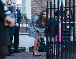 © London News Pictures. 19/02/2013. London, UK.  Catherine Duchess of Cambridge talking to two children as she leaves Hope House addiction centre for women in South London on February 19, 2013. The Duchess met clients and staff at Hope House, which is a 23-bed residential treatment centre for women with substance dependance. The Action Photo credit: Ben Cawthra/LNP