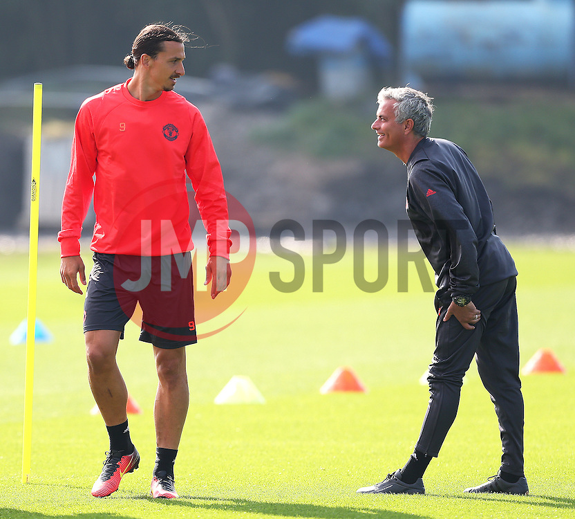 Zlatan Ibrahimovic of Manchester United shares a joke with Jose Mourinho as the manager stretches his hamstrings - Mandatory by-line: Matt McNulty/JMP - 14/09/2016 - FOOTBALL - Manchester United - Training session ahead of Europa League Group A match against Feyenoord