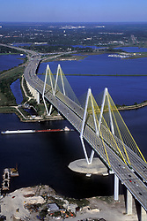 Aerial view of a barge passing under the Fred Hartman Bridge at the Port of Houston