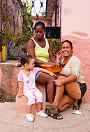 Women with young girl in Cardenas, Matanzas, Cuba.