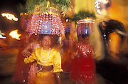 Sri Lanka. Katargama festival in the south west of the country. 'Kavadi' dancers at the night procession leave the entrance to the main Hindu shrine.