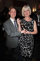 MICHELLE McDOWELL chair of civil and structural engineering at design agency BDP and winner of the 38th Veuve Clicquot Business Woman Award and her partner JASON FOX at the 38th Veuve Clicquot Business Woman Award held at Claridge's, Brook Street, London W1 on 28th March 2011.
