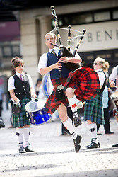 Craig Lawrie from Clydebank Pipe Band in Argyle Street, Glasgow, jumps in the air with his kilt flowing in the wind..©2007 Michael Schofield. All Rights Reserved.