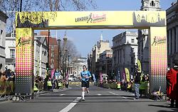 A competitor crosses the finish line during the 2019 London Landmarks Half Marathon.