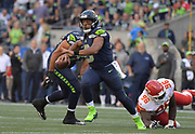 Aug 25, 2017; Seattle, WA, USA; Seattle Seahawks quarterback Russell Wilson (3) is pressured by Kansas City Chiefs defensive tackle Bennie Logan (96) during a NFL football game at CenturyLink Field.