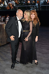Left to right, SAM MCKNIGHT, KATE MOSS and CHARLOTTE TILBURY at British Vogue's Centenary Gala Dinner in Kensington Gardens, London on 23rd May 2016.