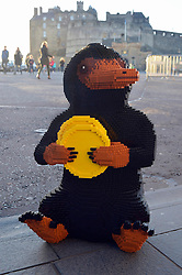 EDITORIAL USE ONLY A LEGO brick Niffler, which is a fan-favourite creature from the new J.K. Rowling film Fantastic Beasts: The Crimes of Grindelwald, appears near Edinburgh Castle to celebrate LEGO Group's new range of Wizarding World play sets, Scotland.