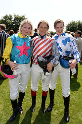 Left to right, KRISSI MURISON, LUCY HENMAN and ALEXIS GREEN at the 3rd day of the 2013 Glorious Goodwood racing festival - Ladies day at Goodwood Racecourse, West Sussex on 1st August 2013.