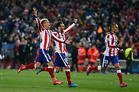 Atletico de Madrid´s Griezmann, Jesus Gamez and Joao Miranda celebrate their victory at the penalty shootouts during the UEFA Champions League round of 16 second leg match between Atletico de Madrid and Bayer 04 Leverkusen at Vicente Calderon stadium in Madrid, Spain. March 17, 2015. (ALTERPHOTOS/Victor Blanco)