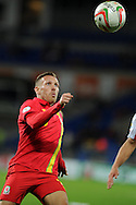 Craig Bellamy of Wales keeps his eye on the ball.  FIFA World cup 2014 qualifying match, Wales v Macedonia at the Cardiff city stadium in Cardiff on Friday 11th October 2013 pic by Andrew Orchard, Andrew Orchard sports photography,