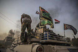 October 19, 2016 - Mosul, Iraq - The battle of Mosul. Iraqi special armed forces rest in a village formerly controlled by the IS. Iraqi and Kurdish Pesmerga fighters have conquered several villages outside Mosul, Iraq from the Islamic State (Daesh).(Credit Image: © AftonbladetIBL via ZUMA Wire)