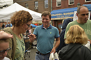 Merrick, New York, USA. 13th September 2014. DAVE DENENBERG, candidate for New York Senate, waves to visitors as they leave the 23rd Annual Merrick Fall Festival & Street Fair when it starts raining.
