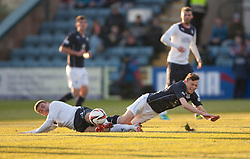 Falkirk's Mark Millar and Dundee's Nicolas Riley.<br /> Dundee 1 v 1 Falkirk, Scottish Championship game at Dundee's home ground Dens Park.