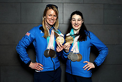 ParalympicsGB's Menna Fitzpatrick (right) and her guide Jennifer Kehoe with their Gold, 2 Silver and Bronze medals as the team arrive at Heathrow Airport, London, following the PyeongChang 2018 Winter Paralympics.