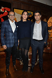 ***UK_MAGAZINES_OUT***<br /> LONDON, ENGLAND 30 NOVEMBER 2016: <br /> Left to right, Krishna Choudhary, Yasmin Calil, Surya Singh at the launch of In The Spirit of Gstaad at Maison Assouline, Piccadilly, London hosted by Mandolyna Theodoracopulos and Homera Sahni England. 30 November 2016.