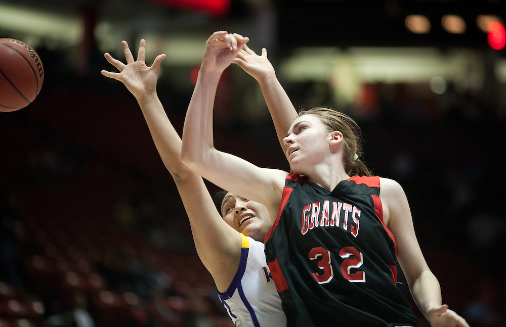 Teige Zeller of Grants battles Meghan Yazzie of Kirtland Central for a rebound during the second half. Kirtland Central defeated Grants 53-49 in the AAAA semifinals Thursday afternoon in Albuquerque at The Pit.