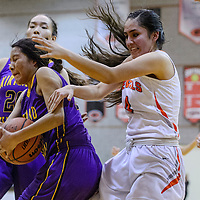 Kirtland Central Bronco Shayonna Begay (14) grabs a rebound away from Gallup Bengal Journey Gillson (4) Tuesday at Gallup High School.