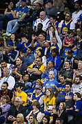 Golden State Warriors fans cheer for their team during a game against the Houston Rockets at Oracle Arena in Oakland, Calif., on March 31, 2017. (Stan Olszewski/Special to S.F. Examiner)