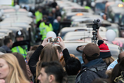 Whitehall, London, February 10th 2016. A woman snaps the blockade of taxis as an estimated 8,000 cabbies hold a go-slow in protest against what they say is unfair competition from minicab and Uber drivers who do not have to undergo the rigorous training and checks required for the licenced taxi trade. ///FOR LICENCING CONTACT: paul@pauldaveycreative.co.uk TEL:+44 (0) 7966 016 296 or +44 (0) 20 8969 6875. ©2015 Paul R Davey. All rights reserved.