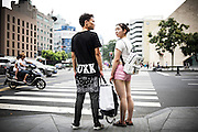 "A young Chinese couple wait to cross the street in the city centre of Chengdu, China, August 10, 2014.<br />   <br /> This picture is part of the series ""Urban Chinese Streets"", a journey on the streets of Chinese cities to discover their modern citizens and habits.        <br /> <br /> © Giorgio Perottino"