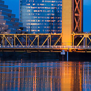 Image of 3 parts of Sacramento icons. From right to left; Tower Bridge, CalSTRS building, and the Zigguart building. Sacramento River, Sacramento, CA