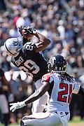 Oakland Raiders wide receiver Amari Cooper (89) catches a pass over Atlanta Falcons cornerback Desmond Trufant (21) at Oakland Coliseum in Oakland, Calif., on September 18, 2016. (Stan Olszewski/Special to S.F. Examiner)