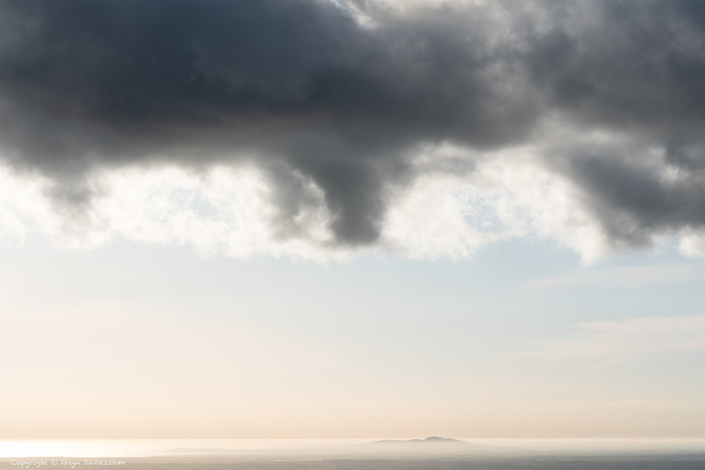 Beautiful, serene, ethereal conditions over Ynys Môn last night, with Mynydd Twr rising out of the sea mist on the North side of the island. Anglesey was once land beneath the Irish Sea, so Holyhead Mountain was momentarily an island once more.