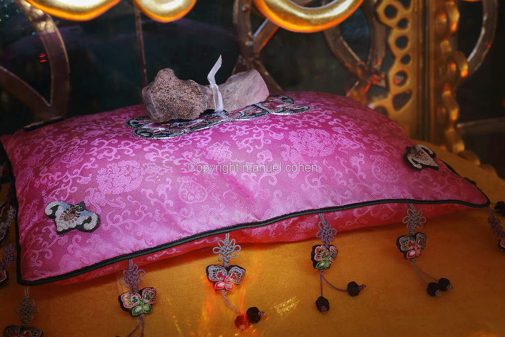 Reliquary of Saint Pierre Aumaitre, with a fragment of his femur on a pink cushion, by Cat-Berro, Orleans, in the Bell tower room themed 'Le Merveilleux' or The Supernatural, first floor, in Le Tresor de la Cathedral d'Angouleme, in Angouleme Cathedral, or the Cathedrale Saint-Pierre d'Angouleme, Angouleme, Charente, France. The 12th century Romanesque cathedral was largely reworked by Paul Abadie in 1852-75. In 2008, Jean-Michel Othoniel was commissioned by DRAC Aquitaine - Limousin - Poitou-Charentes to display the Treasure of the Cathedral in some of its rooms, which opened to the public on 30th September 2016. Picture by Manuel Cohen. L'autorisation de reproduire cette oeuvre doit etre demandee aupres de l'ADAGP/Permission to reproduce this work of art must be obtained from DACS.