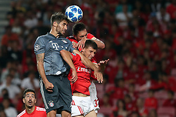 September 19, 2018 - Lisbon, Portugal - Bayern Munich's midfielder Javi Martinez from Spain heads the ball with Benfica's Brazilian defender Jardel and Portuguese defender Ruben Dias (R ) during the UEFA Champions League Group E football match SL Benfica vs Bayern Munich at the Luz stadium in Lisbon, Portugal on September 19, 2018. (Credit Image: © Pedro Fiuza/NurPhoto/ZUMA Press)