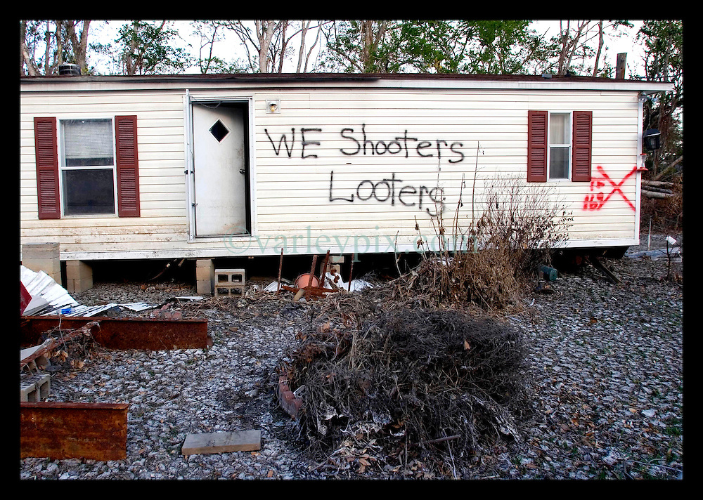 3rd November, 2005. A stark warning sign spray painted onto the side of a trailer in Saint Bernard parish just south of New Orleans. Hurricane Katrina caused a 20ft tidal surge to sweep over the land, devastating much of the parish.