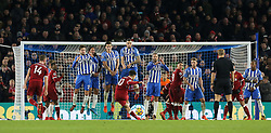 """Liverpool's Philippe Coutinho scores his side's fourth goa during the Premier League match at the AMEX Stadium, Brighton. PRESS ASSOCIATION Photo Picture date: Saturday December 2, 2017. See PA story SOCCER Brighton. Photo credit should read: Gareth Fuller/PA Wire. RESTRICTIONS: EDITORIAL USE ONLY No use with unauthorised audio, video, data, fixture lists, club/league logos or """"live"""" services. Online in-match use limited to 75 images, no video emulation. No use in betting, games or single club/league/player publications."""