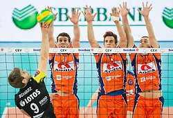 Sebastian Schwarz of Lotos Trefl Gdansk vs Eric Mochalski of ACH, Jan Kozamernik of ACH and Andrej Flajs of ACH during volleyball match between ACH Volley (SLO) and Lotos Trefl Gdansk (POL) in 3rd Leg of Pool F of 2016 CEV DenizBank Volleyball Champions League, on December 3, 2015 in Arena Stozice, Ljubljana, Slovenia. Photo by Vid Ponikvar / Sportida