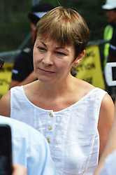 © Licensed to London News Pictures. 18/08/2013. Balacombe, UK Balcombe, UK. Caroline Lucas of the Green Party. Campaigners gather outside of the entrance to the Cuadrilla drilling site in Balcombe, West Sussex which has been earmarked for fracking. Cuadrilla has temporarily ceased drilling at the site under advice from the police after campaign group No Dash For Gas threatened a weekend of civil disobedience.  Photo credit : Aiden Jordan/LNP