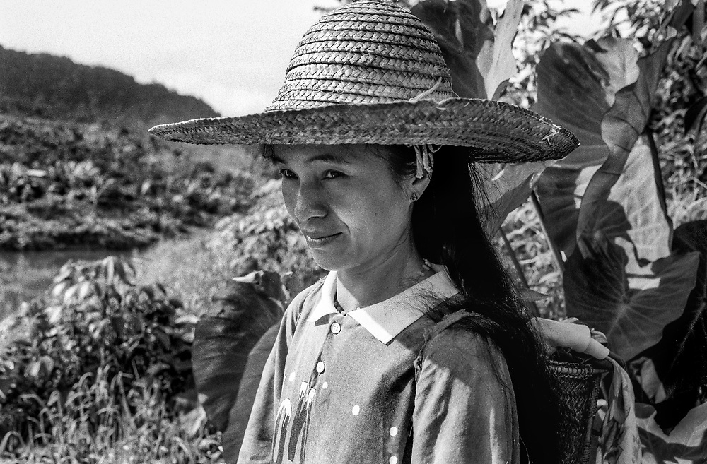 Young female wearing traditional hat, Murut hill tribe, on the banks of the Tough river, Malaysia, Sabah, Borneo 1992