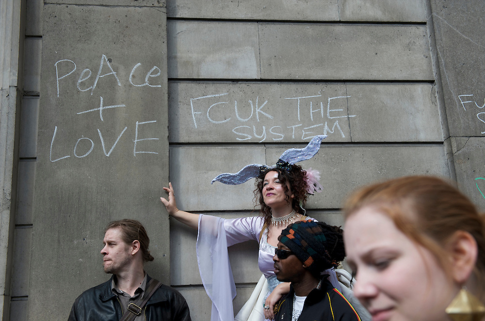 Anti-captialist messages are written in chalk on the side of the Bank of England during a rally on the first day of the G20 Summit in London on April 1, 2009.  Many protesters were decked out in garb themed by the four horses of the apocalypse.  Police lined the streets in anticipation of violence.