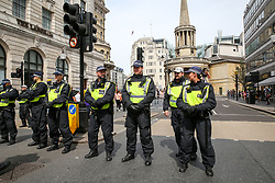 """© Licensed to London News Pictures. 03/08/2019. London, UK. Large police presence during """"Free Tommy Robinson Protest"""" in central London. Last month Stephen Yaxley-Lennon, known as Tommy Robinson was given a nine-month prison sentence at Old Bailey after he was found guilty of contempt of court. Photo credit: Dinendra Haria/LNP"""