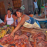 Merchants sell bananas & exotic meats in an outdoor market in upper Belem, a crowded neighborhood in Iquitos, Peru.