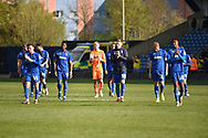 The AFC Wimbledon players applaud the fans during the EFL Sky Bet League 1 match between Oxford United and AFC Wimbledon at the Kassam Stadium, Oxford, England on 13 April 2019.