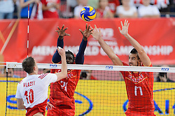 14.09.2014, Luczniczka Hall, Bydgoszcz, POL, FIVB WM, Polen vs Frankreich, 2. Runde, Gruppe E, im Bild Mariusz Wlazly, Mory Sidibe, Franck Lafitte // during the FIVB Volleyball Men's World Championships 2nd Round Pool F Match beween Poland and France at the Luczniczka Hall in Bydgoszcz, Poland on 2014/09/14. EXPA Pictures © 2014, PhotoCredit: EXPA/ Newspix/ Mariusz Palczynski<br /> <br /> *****ATTENTION - for AUT, SLO, CRO, SRB, BIH, MAZ, TUR, SUI, SWE only*****