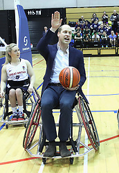 The Duke of Cambridge, watched by the Duchess, as he tries his hand at wheelchair basketball during a SportsAid event at the Copper Box in the Olympic Park, London.