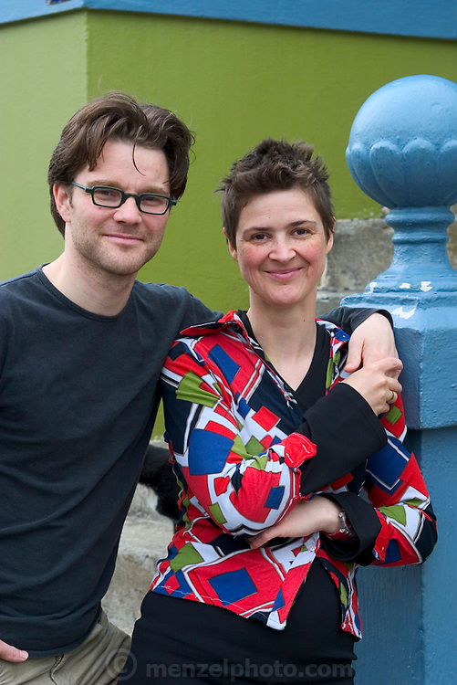 """Icelandic sculptor Ilmur Stefnsdottir and her partner, the actor Valur Freyr Einarsson. Ilmur, pregnant with her fourth child, is experimenting with a piece of her performance art; focusing on the connection between people and objects and using common objects in an uncommon fashion.  """"People misunderstand objects in their environment,"""" she says, """"I'm exploring visually how this happens."""" Valur occasionally acts in performances that center on his partner's artworks; most recently in a show called Common Nonsense that they and a troupe of actors performed in Reykjavik, Stockholm, and London. MODEL RELEASED."""