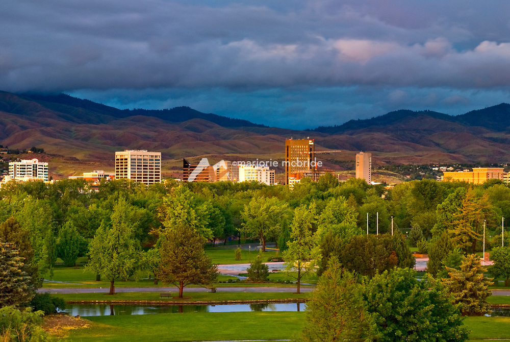Sunset over downtown Boise skyline and Ann Morrison Park on a cloudy spring evening, Idaho.