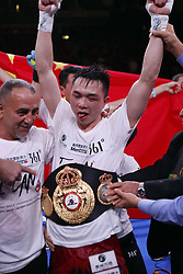 HOUSTON, Jan. 27, 2019  Xu Can (C) of China celebrates during the awarding ceremony after winning the World Boxing Association (WBA) featherweight champion in Houston, the United States, on Jan. 26, 2019. Xu Can lifted China's first ever World Boxing Association title here on Saturday after he defeated defending champion Jesus Rojas of Puerto Rico by unanimous decision. (Credit Image: © Steven Song/Xinhua via ZUMA Wire)