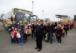 Lincoln City fans before departing from Sincil Bank in Lincoln for the Emirates FA Cup match with Arsenal.