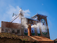 CHEFCHAOUEN, MOROCCO - CIRCA MAY 2018: Typical street and rooftop of Chefchaouen in Morocco.
