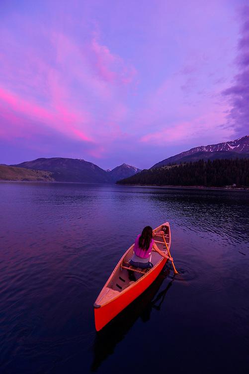 Woman canoeing at sunset, Wallowa Lake, Oregon.