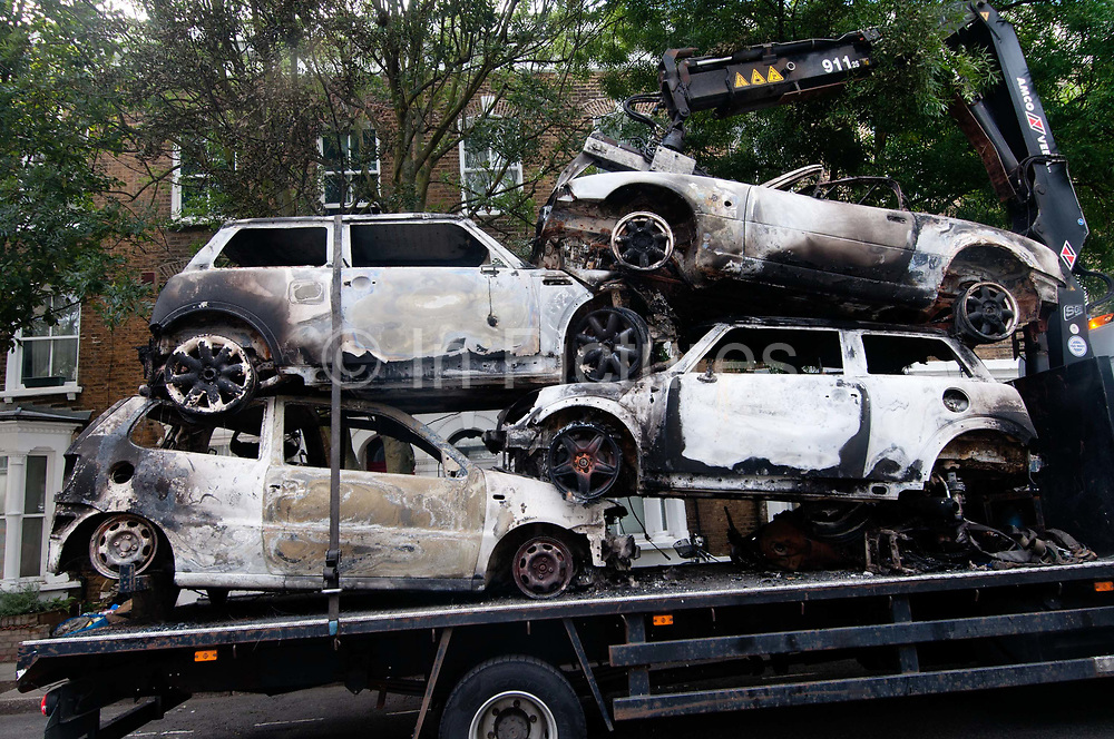 Hackney August 9th 2011. Removing burnt out cars from last night's riot.